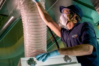 Technician performing HVAC restoration