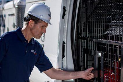 DUCTZ service technician performing multi-unit dryer vent service