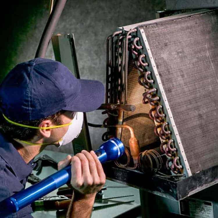DUCTZ technician inspecting coils