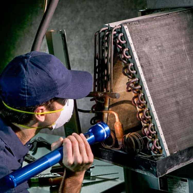 DUCTZ technician inspecting coils
