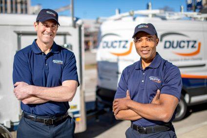 DUCTZ Technicians in front of service trucks